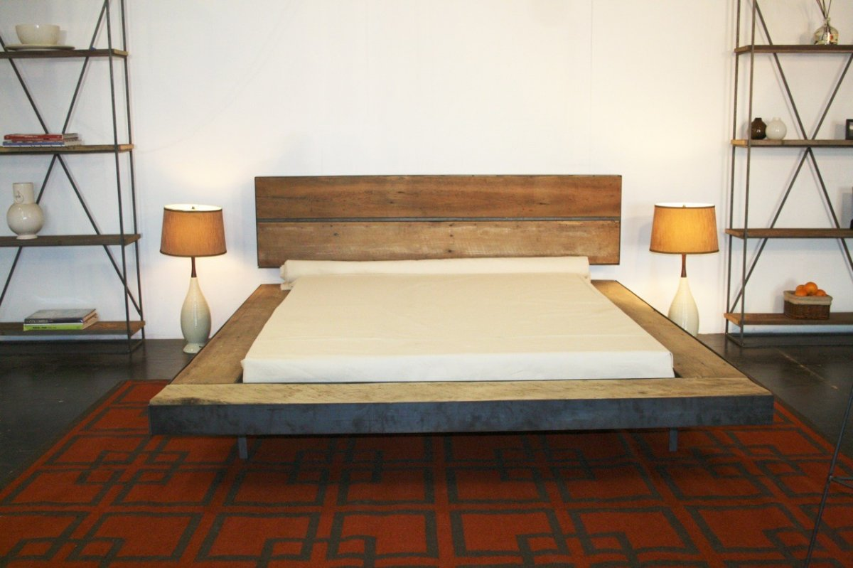 rustic low profile bed design with simple and easy DIY wooden base and headboard plus 2 floor lamps and furniture rack storage ideas
